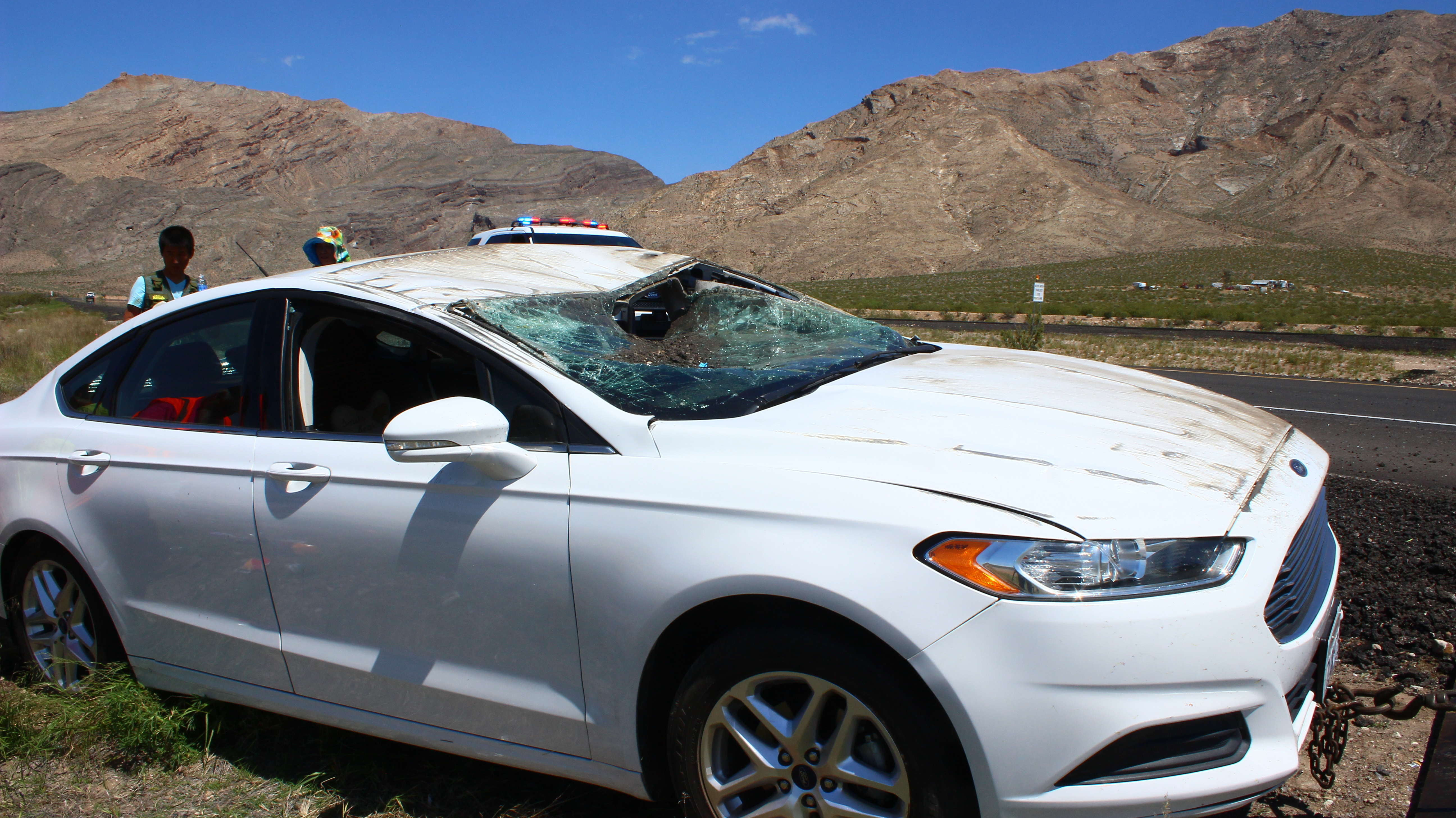 Rollover in Arizona damages vehicle occupants sustain minor
