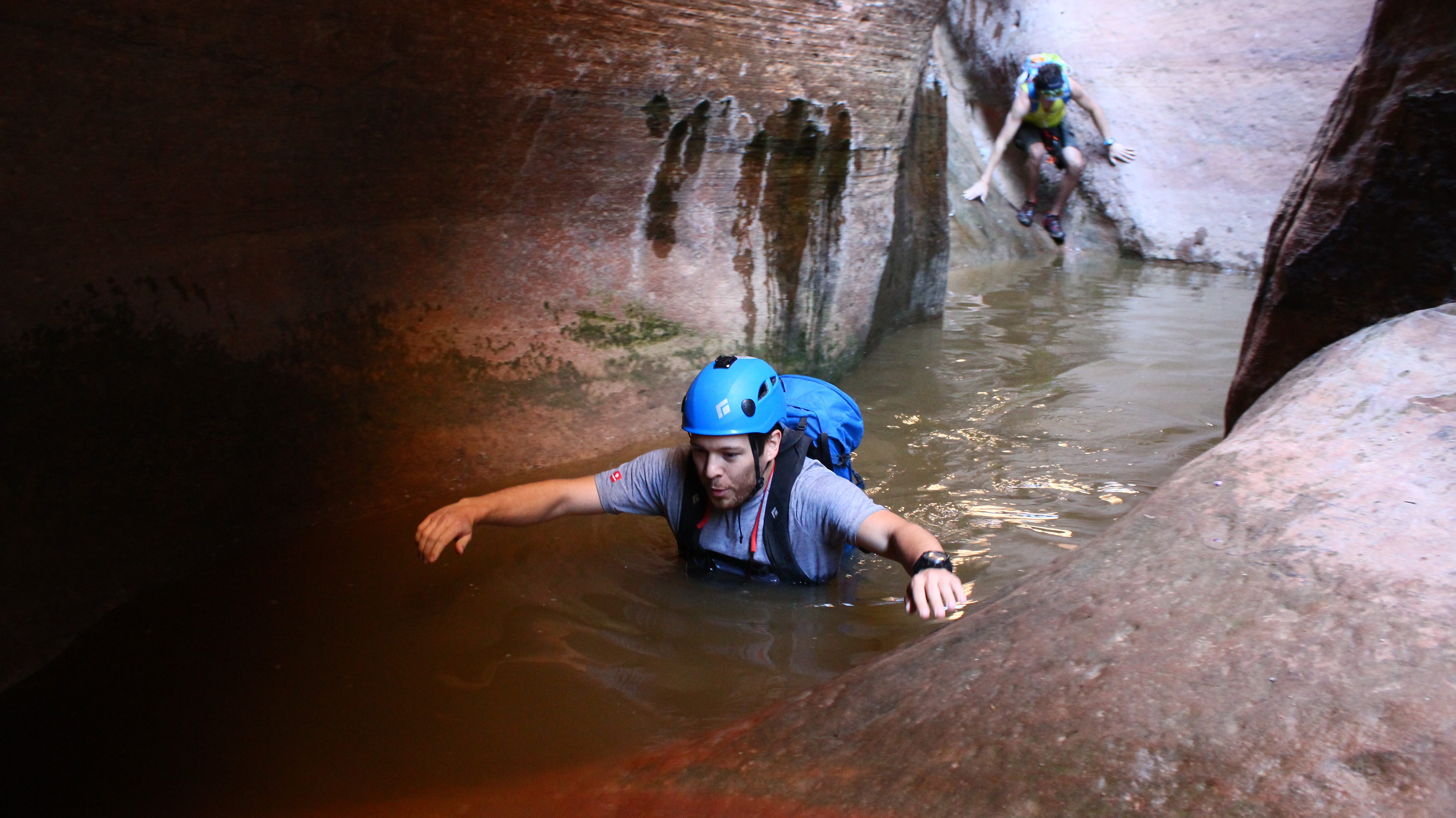 Kevin Arnone wades through chilly water, one of many such pools encountered in the descent of Yankee Doodle Canyon, Leeds, Utah, May 19, 2016 | Photo by Don Gilman, St. George News