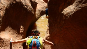 Weston Hargis prepares to immerse himself in one of the many cold pools of water encountered in Yankee Doodle Canyon, Leeds, Utah, May 19, 2016 | Photo by Don Gilman, St. George News