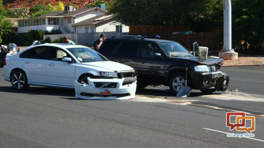 A collision at 1091 N. Bluff Street resulted in both vehicles being towed and a citation issued for the driver of a white Volvo passenger vehicle. St. George, Utah, May 25, 2016 | Photo by Don Gilman, St. George News