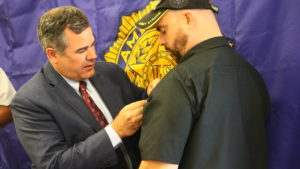 Mayor Jon Pike pins the Medal of Valor on veteran Joe Hamblin during an award ceremony at the American Legions Post 90, St. George, Utah, May 25, 2016 | Photo by Don Gilman, St. George News