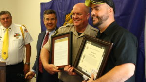 Washington County Sheriff Cory Pulsipher and Medal of Valor recipient Joe Hamblin display some of the numerous awards Hamblin received during an award ceremony at the American Legion Post 90 in St. George, Utah, May 25, 2016 | Photo by Don Gilman, St. George News