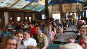 Friends and family members look on at a ceremony honoring five young men who had achieved the rank of Eagle Scout, Leeds, Utah, May 28, 2016 | Photo by Don Gilman, St. George News