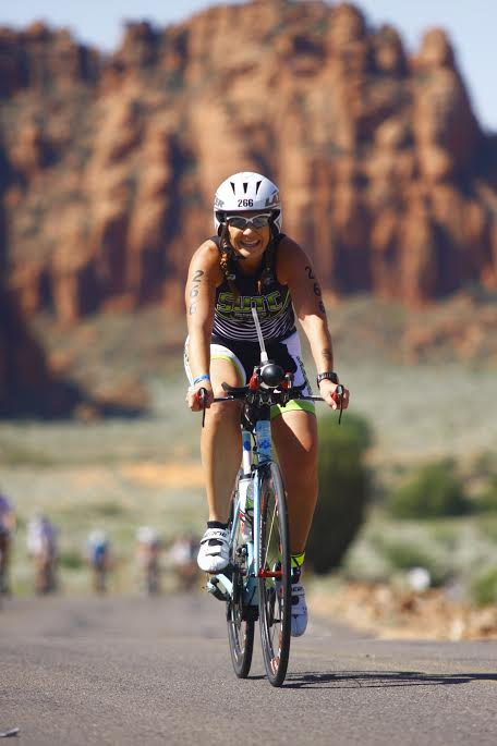 Tiffany Gust rides her bike up Snow Canyon State Park during the Ironman 70.3 St. George. Ivins, Utah, date not specified | Photo courtesy of Tiffany Gust, St. George News