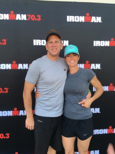 L-R Heath Snow and Tara Snow pose together in front of and Ironman 70.3 backdrop. Location and date not specified | Photo courtesy of Tara Snow, St. George News