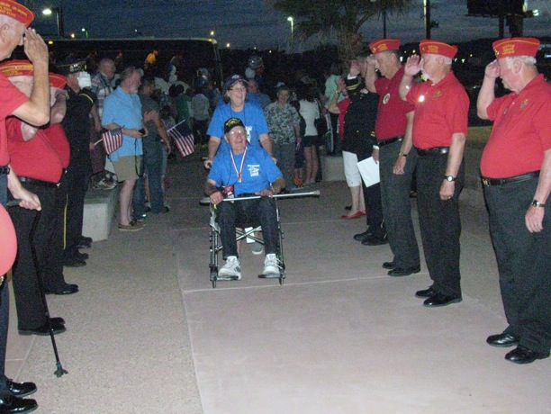 Members of Utah Dixie Detachment 1270 and the American Legion Post 90 form a line and render a salute to welcome home members of the Utah Honor Flight at Dixie Center St. George Saturday Night. St. George, Utah, May 28, 2016 | Photo courtesy of William Fortune, St. George News