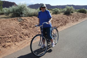 Moreen Franklin riding on Snow Canyon Parkway. Franklin was visiting from New Hampshire, getting some exercise while exploring the Ivins/Snow Canyon area. May 25, 2016| Photo courtesy of Tim Tabor, St. George News