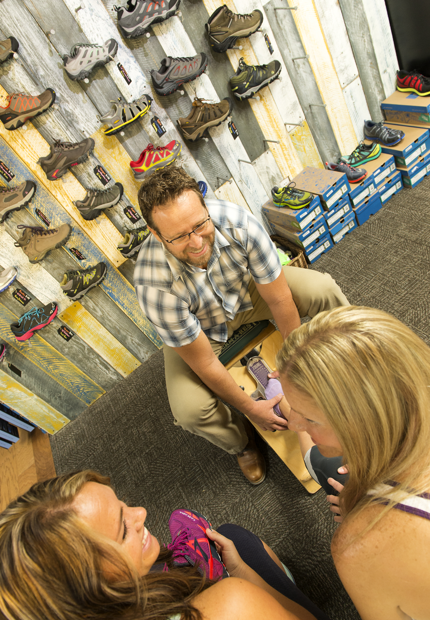 Rob Bolding providing customers a custom shoe Fitting at Red Mountain Outfitters in Ivins, Utah, date unknown | Photo courtesy of Red Mountain Resort, St. George News