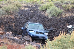 An elderly couple were injured when their car lost control on a turn on Pioneer Parkway and rolled into the lava beds. Santa Clara, Utah, May 7, 2016 | Photo by Ric Wayman, St. George News