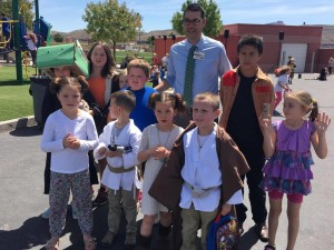"""Hurricane Elementary Title 1 coordinator. Matthew Lowe poses with students as they celebrate """"Star Wars Day."""" Hurricane, Utah, May 4, 2016 