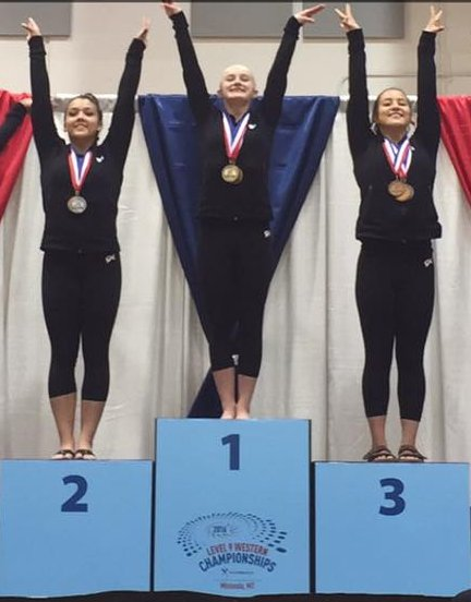 Rebekah Bean (center) on the podium at the USA Gymnastics Level 9 2016 Women's Junior Olympic Western Championships, Adams Center, University of Montana, Missoula, Montana, May 1, 2016 | Photo courtesy of Laura Bean, St. George News