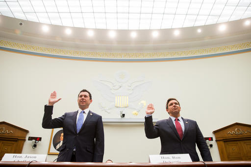 House Judiciary Committee members, Rep. Jason Chaffetz, R-Utah, left, and Rep. Ron DeSantis, R-Fla., are sworn in Capitol Hill in Washington, Tuesday, May 24, 2016, prior to testifying before the Judiciary Committee's hearing on allegations of misconduct against IRS Commissioner John Koskinen. (AP Photo/Andrew Harnik)