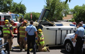 Failure to stop at a stop sign caused a Toyota FJ Cruiser to roll on its side Monday afternoon, St. George, Utah, May 9, 2016 | Photo by Ric Wayman, St. George News