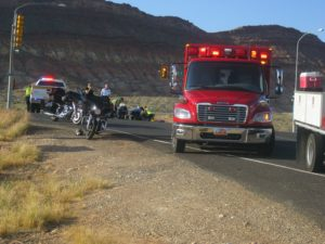 Paramedics and other officials stabilize a German tourist who was involved in a motorcycle mishap Wednesday, Hurricane, Utah, May 25, 2016 | Photo by Ric Wayman, St. George News