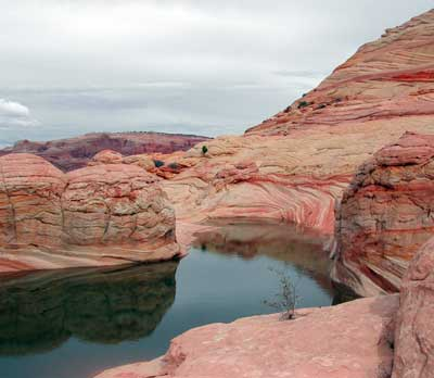 A large pool of water remains after a summer thunderstorm at Coyote Buttes North in the Paria Canyon-Vermilion Cliffs Wilderness area managed by the Bureau of Land Management, Utah and Arizona, circa 2012 | Photo courtesy of the BLM, St. George News