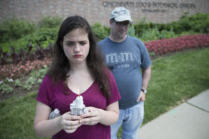 Bettina Ernsg, of Cincinnati, holds a candle alongside her father John, right, during a vigil outside the Cincinnati Zoo & Botanical Garden, Monday, May 30, 2016, in Cincinnati. Animal rights activists gathered Monday for a Memorial Day vigil for Harambe, the gorilla killed at the Cincinnati Zoo on Saturday after a 4-year-old boy slipped into an exhibit and a special zoo response team concluded his life was in danger. Cincinnati, Ohio, May 30, 2016 | Photo by John Minchillo (AP), St. George News