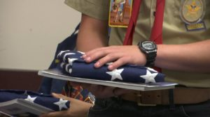 Veterans participating in the Utah Honor Flight are presented with an American flag from a member of Boy Scout troop 1495. St. George, Utah, May 28, 2016 | Photo by Austin Peck, St. George News