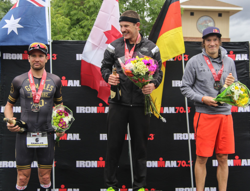 Winner's podium with winner Lionel Sanders (center), second place Sebastian Kienle (right) and third-place Joe Gambles (left), Ironman 70.3, St. George, Utah, May 7, 2016, | Photo by Kevin Luthy, St. George News