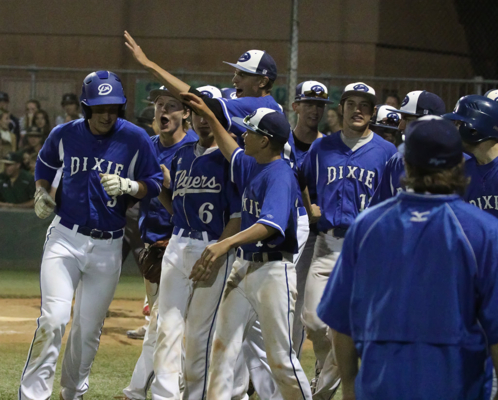 Dixie's Chance Vowell (3), is congratulated by his teammates after hitting a home run Snow Canyon vs. Dixie, Baseball, St. George, Utah, May 5, 2016, | Photo by Kevin Luthy, St. George News