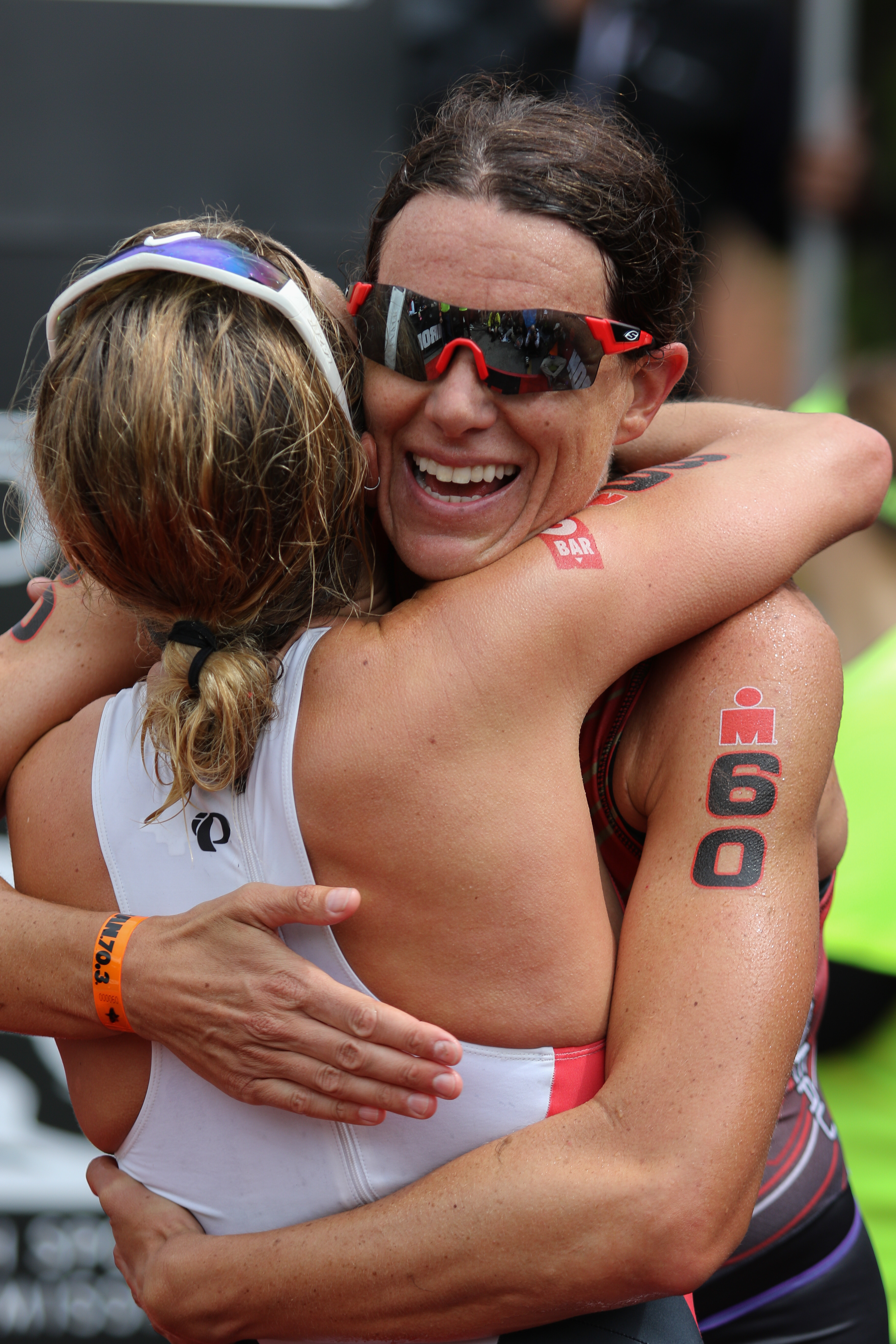 Women's pro winner Heather Wurtele (60) hugs second-place finisher Holly lawrence, Ironman 70.3,  St. George, Utah, May 7, 2016, | Photo by Kevin Luthy, St. George News