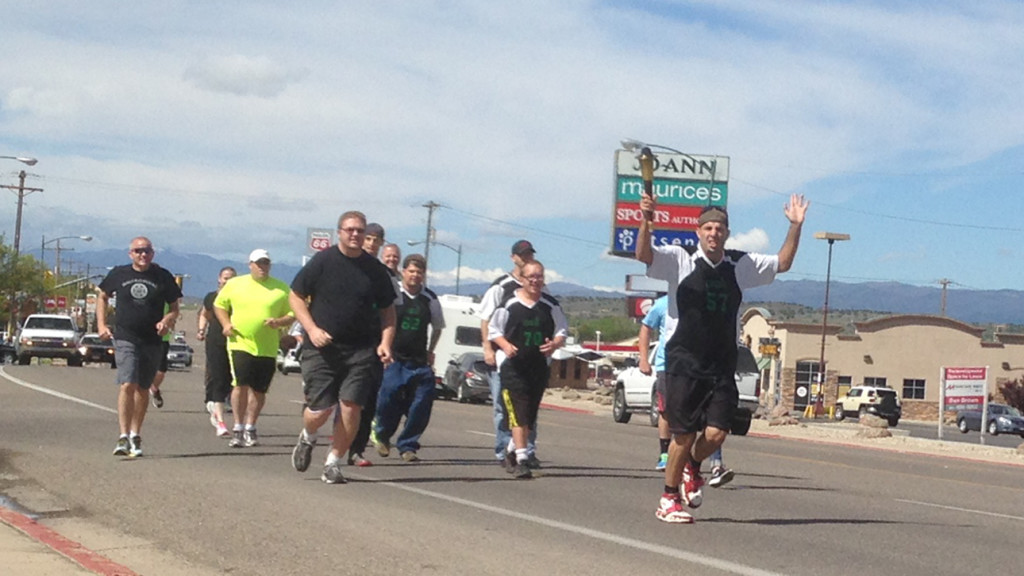 Athletes took turns running with the Flame of Hope down Main Street, Cedar City, Utah, May 18, 2016 | Photo by Paul Dail, St. George News