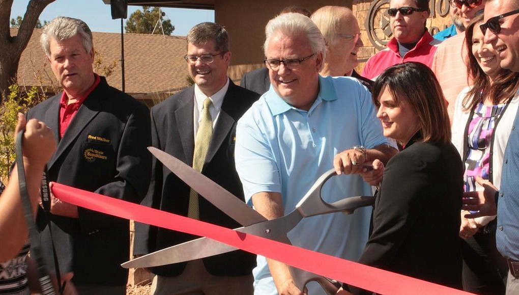 File photo - Darcy Stewart (blue shirt) helps cut the ribbon marking the reopening of the Bloomington Country Clubhouse. The building's renovations are a part of the ongoing effort to revitalise the Bloomington Country Club and golf course, St. George, Utah, March 31, 2016 | Photo by Don Gilman, St. George News