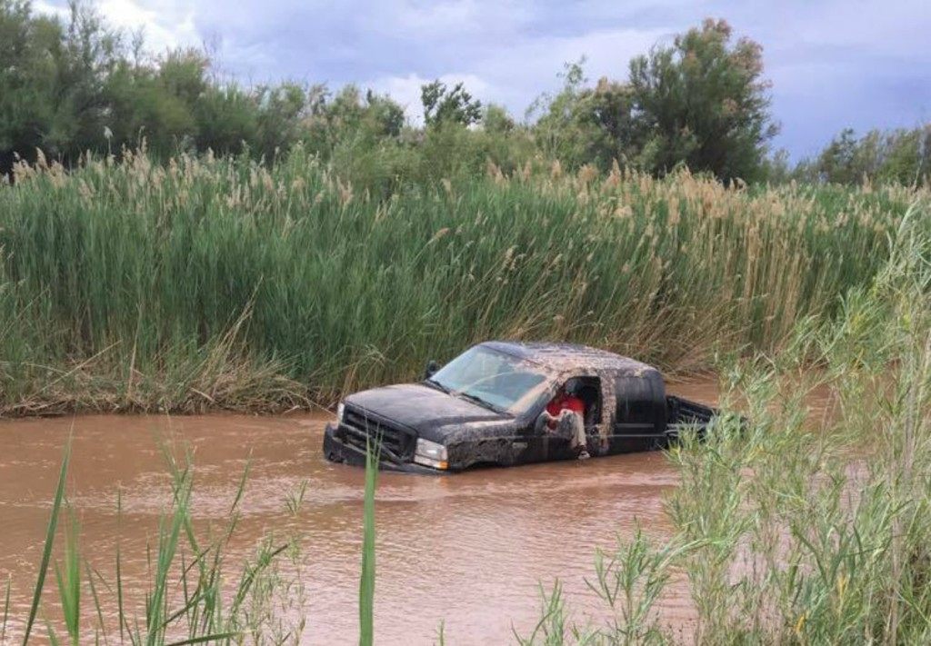 A joyride into the Virgin River ended abruptly when the truck dropped into a large hole and got struck, St. George, Utah, May 17, 2016 | Photo courtesy of Elise Marie Tuttle, St. George News