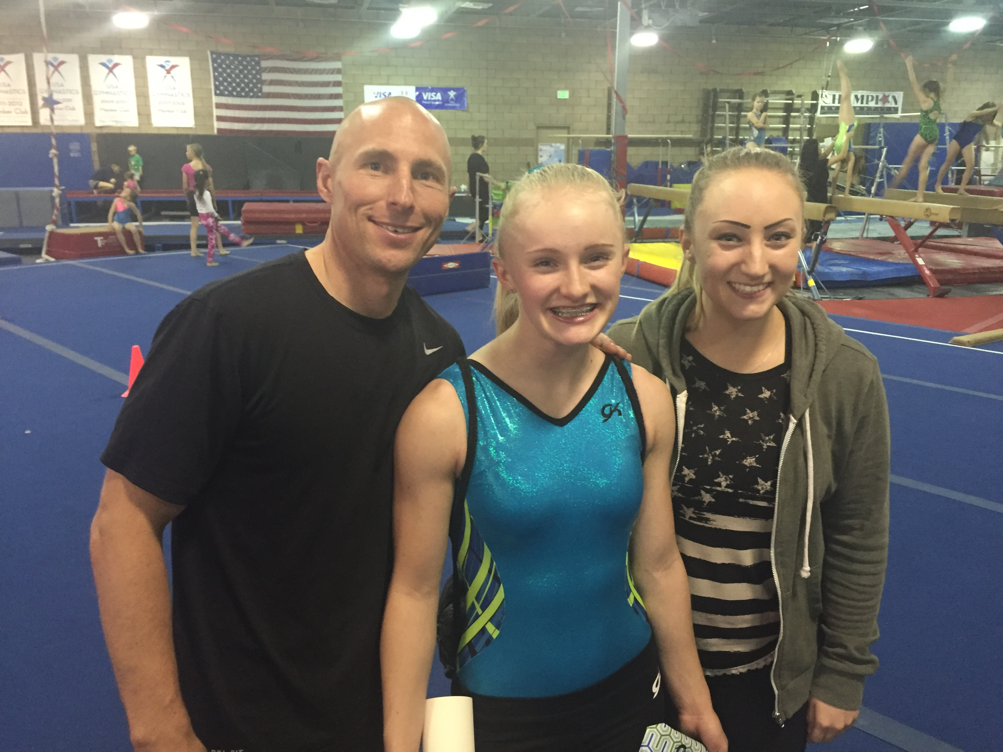 Rebekah Bean (center) with her coaches Jeremy Graff and Erika Almondinger. USA Gymnastics Level 9 2016 Women's Junior Olympic Western Championships, Adams Center, University of Montana, Missoula, Montana, May 1, 2016 | Photo courtesy of Laura Bean, St. George News