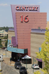 "In this file photo, an overhead view from a neighboring rooftop gives a view of activities at the Century 16 theatre east of the Aurora Mall. The theatre was the scene of a calculated ambush in which 12 people died and 70 people were injured in a bloody assault during a midnight premiere of ""The Dark Knight."" In a civil trial starting Monday, May 9, 2016, 28 victims' families will argue that Century Theatres should be held accountable for not doing more to prevent the bloody rampage. Aurora, Colorado, July 20, 2012 
