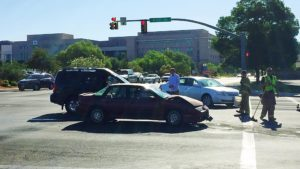 Two vehicles collided at the 700 South and River Road intersection when one of the drivers allegedly failed to obey the traffic signal, St. George, Utah, June 14, 2016 | Photo by Kimberly Scott, St. George News