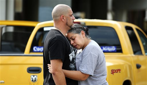 Ray Rivera, left, a DJ at Pulse Orlando nightclub, is consoled by a friend, outside of the Orlando Police Department after a shooting involving multiple fatalities at the nightclub, Sunday in Orlando, Florida, June 12, 2016 | Photo by Joe Burbank/Orlando Sentinel via AP; St. George News