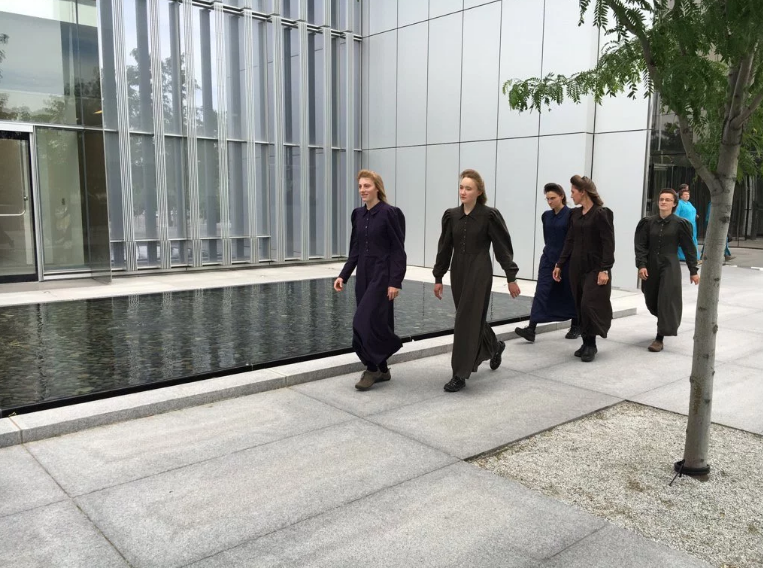 This June 9, 2016, photo shows FLDS Church members leaving federal court after their leader, Lyle Jeffs, was released from custody and placed under house arrest pending trial in a food stamps fraud case. Salt Lake City, Utah, June 9, 2016 | Image by and courtesy of Ben Winslow, FOX 13 News; St. George News