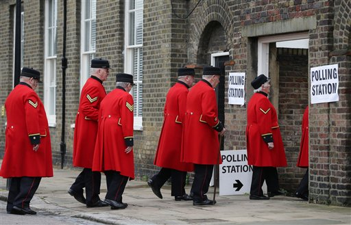 Chelsea pensioners arrive at a polling station near to the Royal Chelsea Hospital, London, to vote in Britain's EU referendum Thursday June 23, 2016. Voters in Britain are deciding Thursday whether the country should remain in the European Union a historic referendum that threatens to undermine the experiment in continental unity that began in the aftermath of World War II. (Daniel Leal-Olivas/PA via AP) UNITED KINGDOM OUT NO SALES NO ARCHIVE