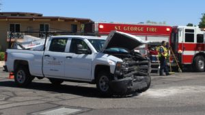 A Chevrolet pickup sits in the middle of 600 South after a crash with a Ford SUV. St. George, Utah, June 15, 2016 | Photo by Ric Wayman, St. George News