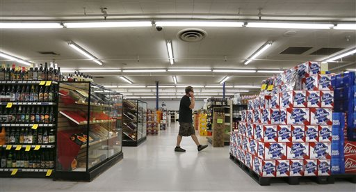 In this June 9, 2016 photo, a customer shops at Liquor Mart in Boulder, Colo. On June 10, Colorado's governor signed a bill to gradually allow grocery stores to sell full-strength beer, liquor and wine, the biggest change to state liquor laws since the end of Prohibition. | AP Photo/Brennan Linsley; St. George News