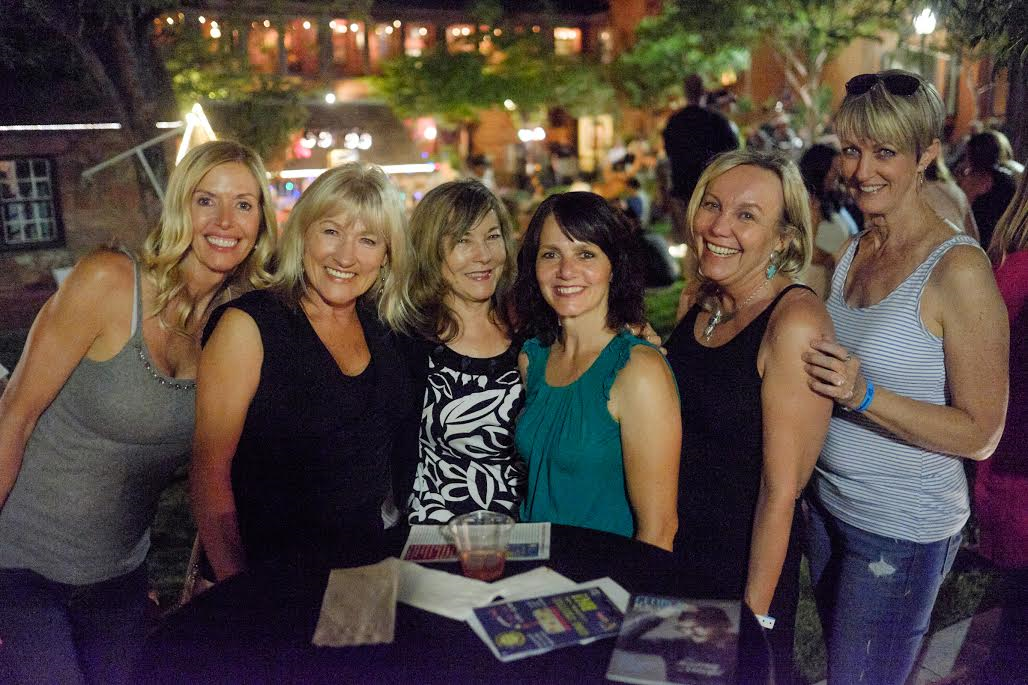 """A group of women poses in the Desert Pulse Jazz Garden in this photo from the """"June Moon Jubilee"""" edition of George Streetfest held in St. George, Utah, June 3, 2016 