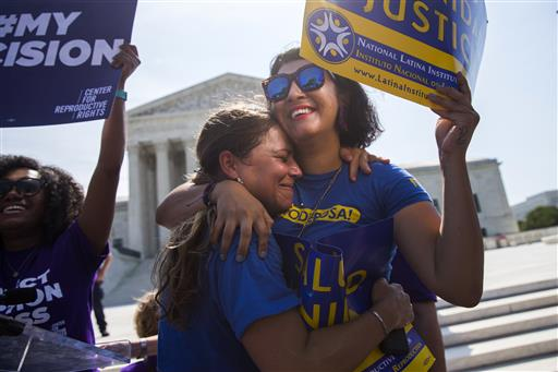 Bethany Van Kampen, left, hugs Alejandra Pablus as they celebrate during a rally at the Supreme Court in Washington, Monday after the court struck down Texas' widely replicated regulation of abortion clinics. The justices voted 5-3 in favor of Texas clinics that had argued the regulations were a thinly veiled attempt to make it harder for women to get an abortion in the nation's second-most populous state. Washington D.C., June 27, 2016 | Photo by  Evan Vucci (AP), St. George News