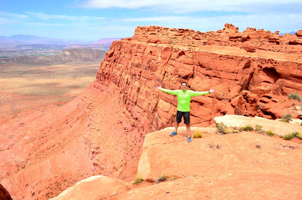 Cory Reese stands on the edge of a cliff during a run in Southern Utah, location and date not specified | Photo courtesy of Cory Reese, St. George News