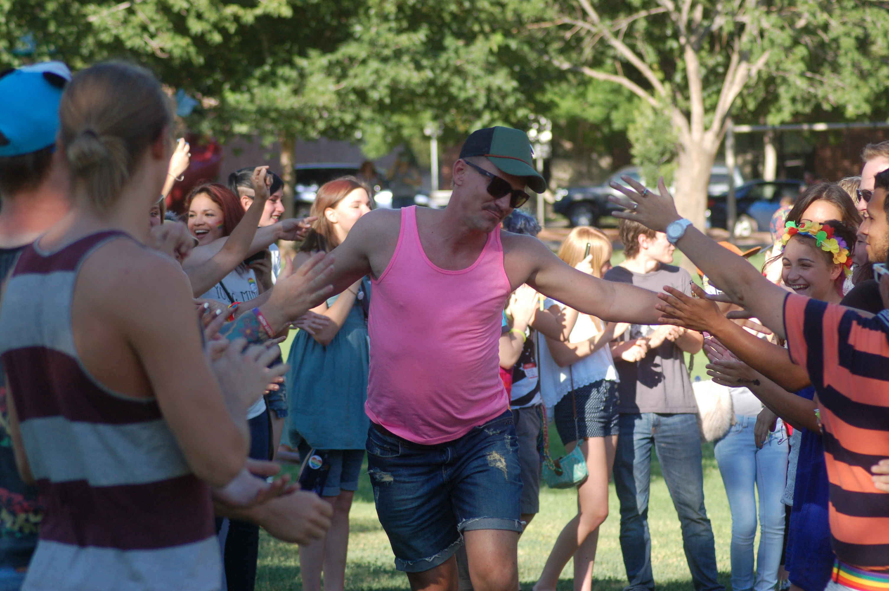 Revelers at the St. George gay pride event participate in a conga line parade at Vernon Worthen Park, St. George, Utah, June 25, 2016 | Photo by Hollie Reina, St. George News