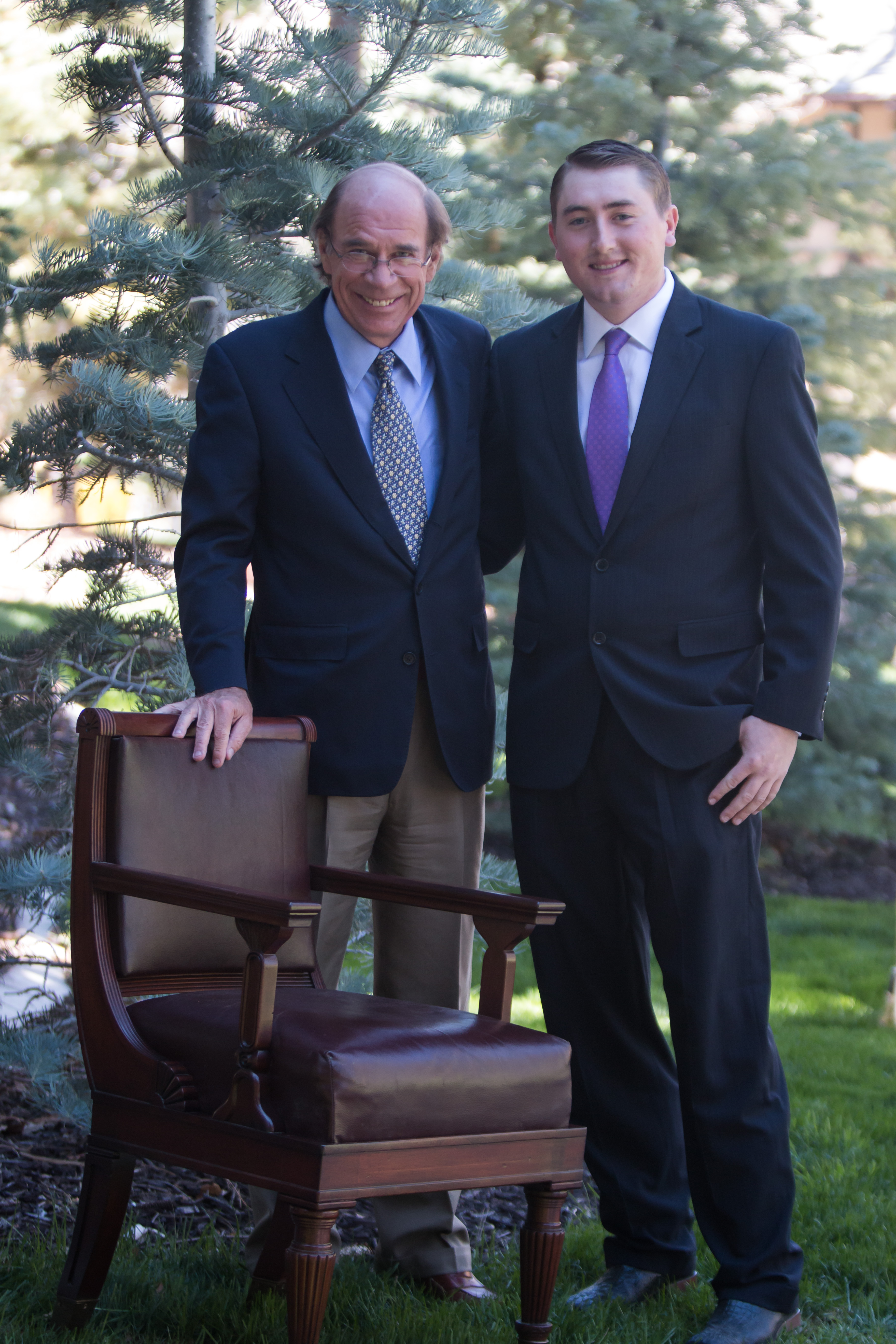 Doug Bennett and Clay Crozier with Senator Wallace F. Bennett's chair, date and location not given | Photo courtesy of Southern Utah University, St. George News / Cedar City News