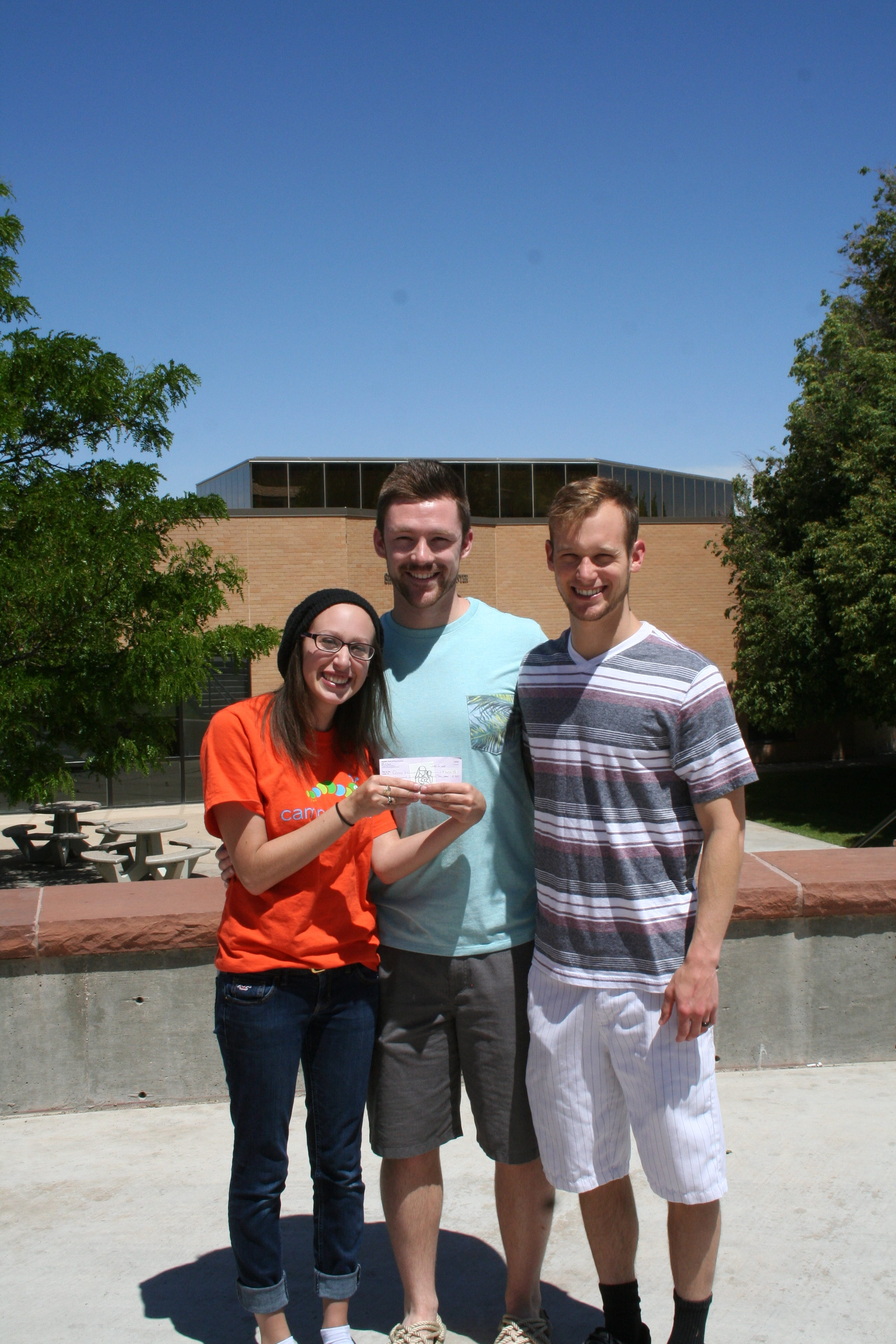SUU students, who serve as Camp Kesem counselors, accept a check from the Moms Club Pink Tea fundraiser, Cedar City, Utah, June 1, 2016   Photo by Kaleigh Bronson, St. George News