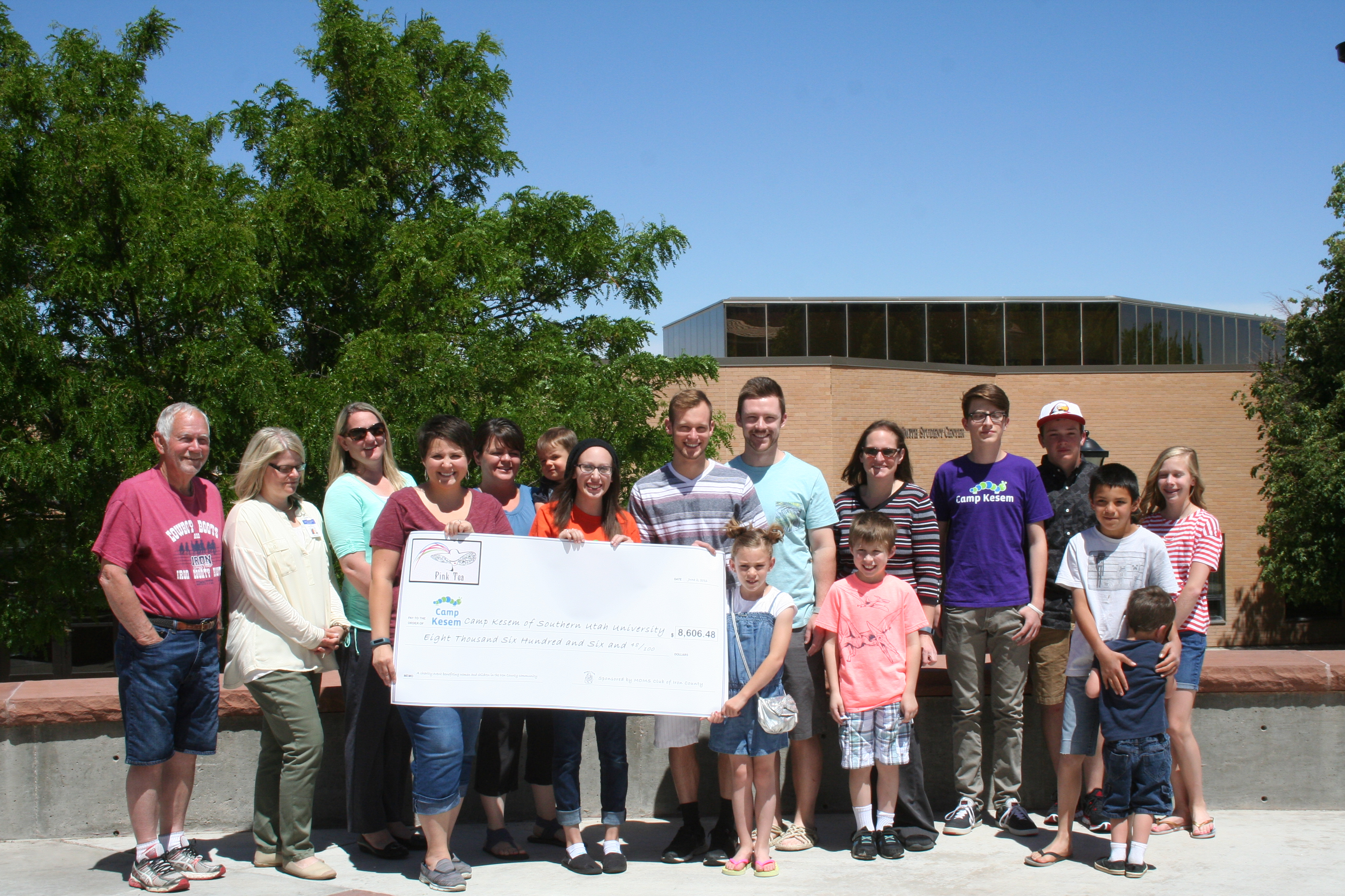 Children and counselors who participate in Camp Kesem receive a check provided through the Pink Tea fundraiser by the Iron County Moms club, Cedar City, Utah, June 1, 2016   Photo by Kaleigh Bronson, St. George News