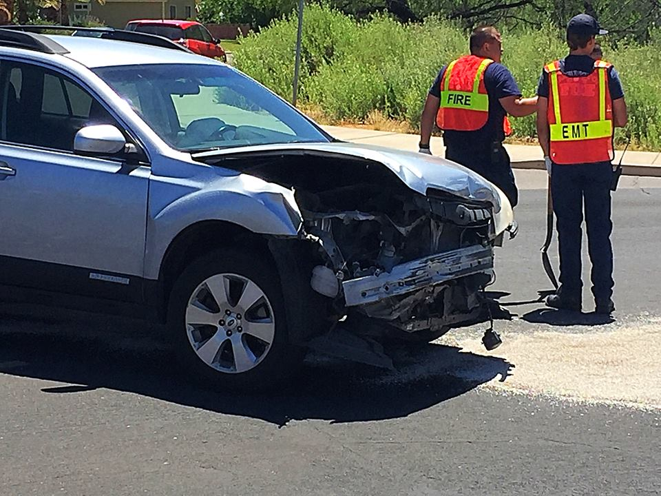 A two-vehicle collision resulted in a blue Scion on the Green Springs Golf Course while the driver of the Scion was taken by ambulance to the hospital, Washington City, Utah, June 17, 2016 | Photo by Kimberly Scott, St. George News