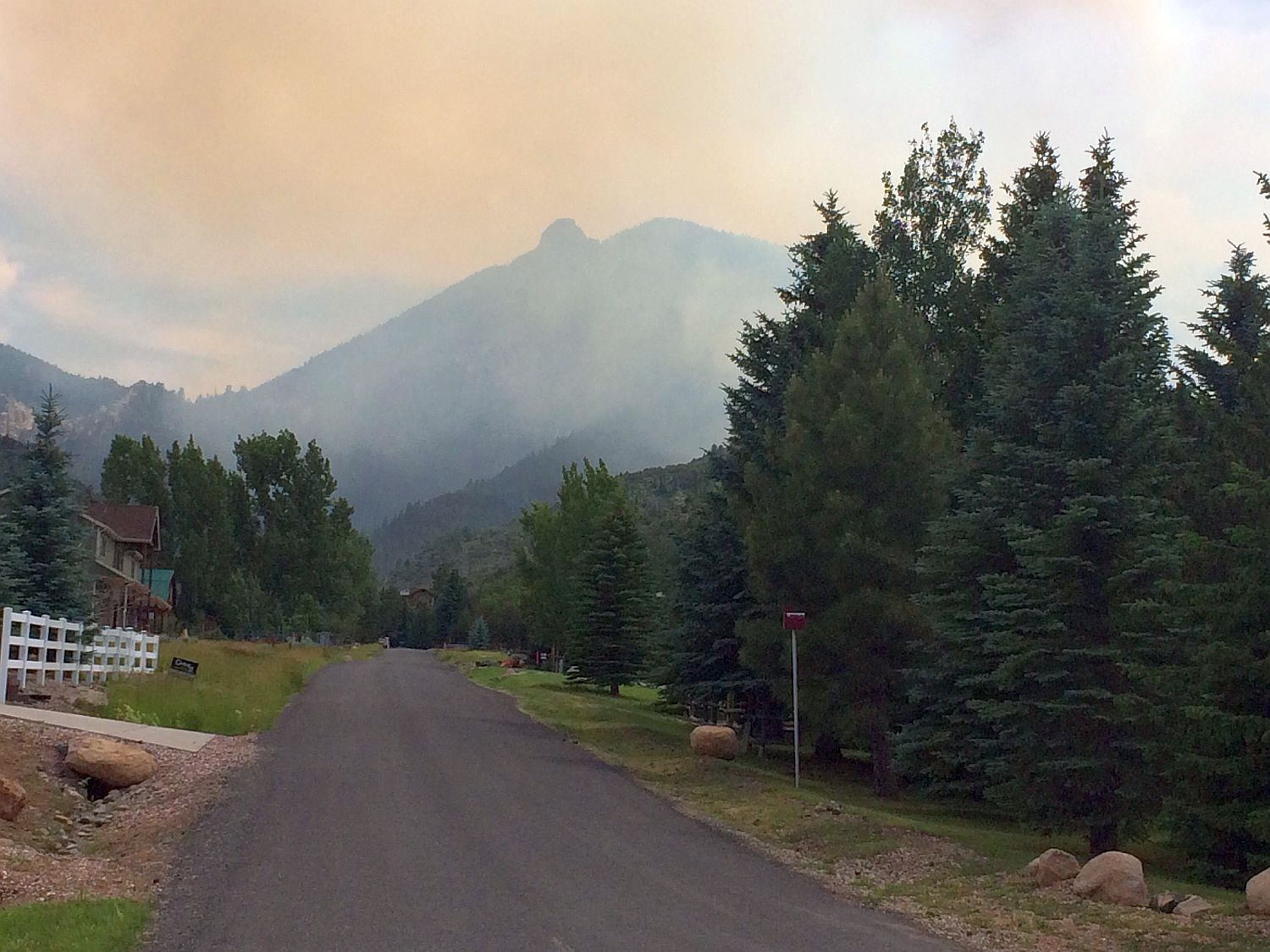 Smoke rises over the hills of Lloyd Canyon Tuesday afternoon. Washington County, Utah, June 21, 2016 | Photo by Tyler Truman, St. George News