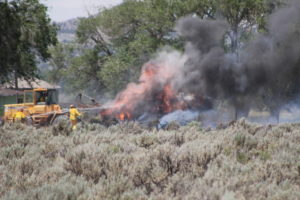 Fire crews worked to put out two fires Friday, together totaling approximately eight acres in the Cedar City area, June 10, 2016 | Photo by Tracie Sullivan, St. George/Cedar City News