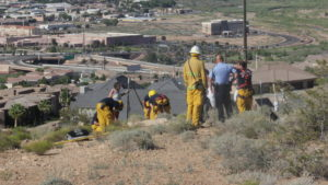 A woman who fell off a cliff above the Bloomington Wal-Mart was rescued by a team from the St. George Fire Department, St. George, Utah, June 2, 2016 | Photo by Don Gilman, St. George News