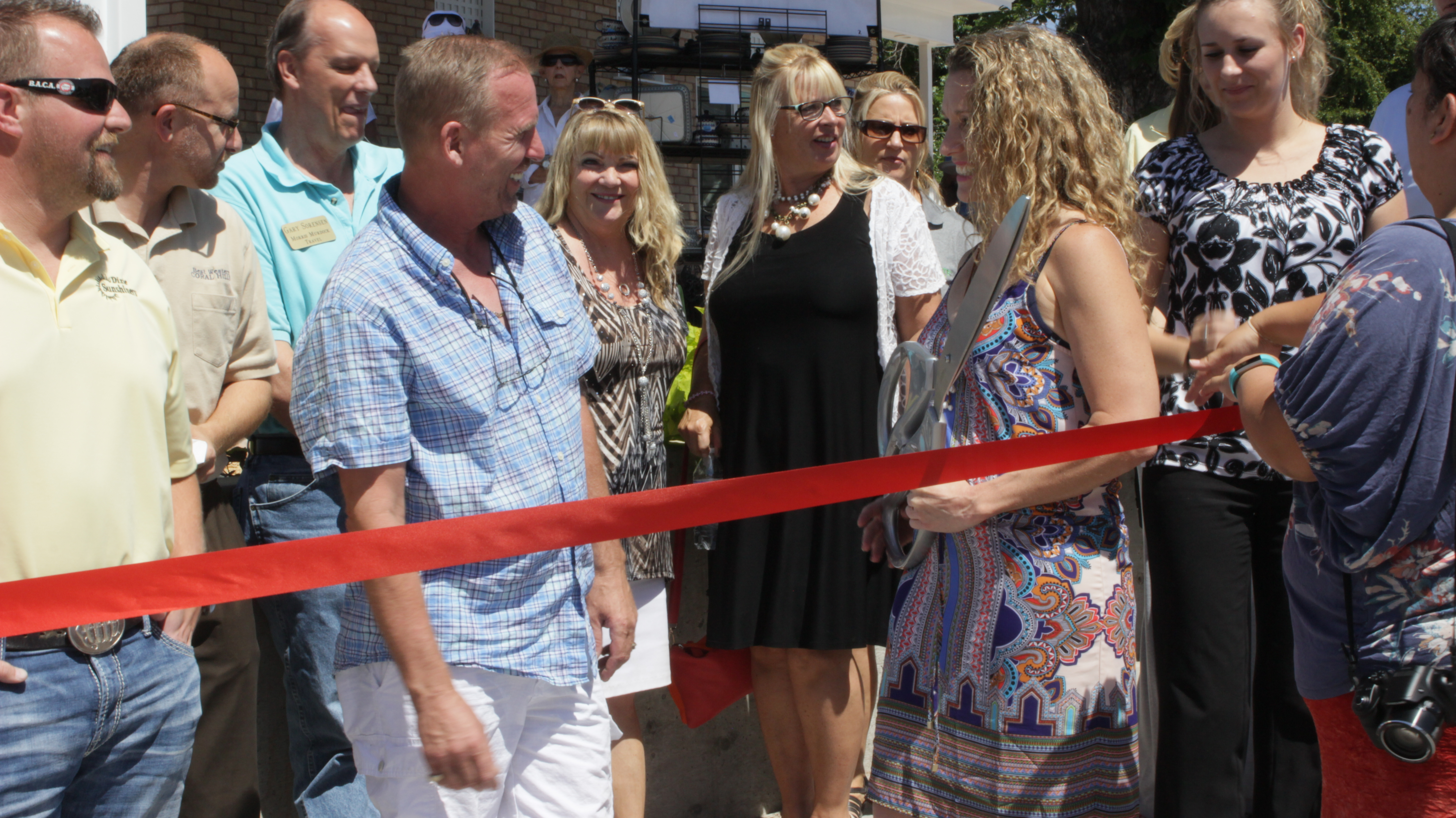 Kelly Chakos (L) and Twila Abrams (R) prepare to cut the ribbon and officially welcome the public to the Pottery Avenue Cottage, St. George, Utah, June 3, 2016 | Photo by Don Gilman, St. George News