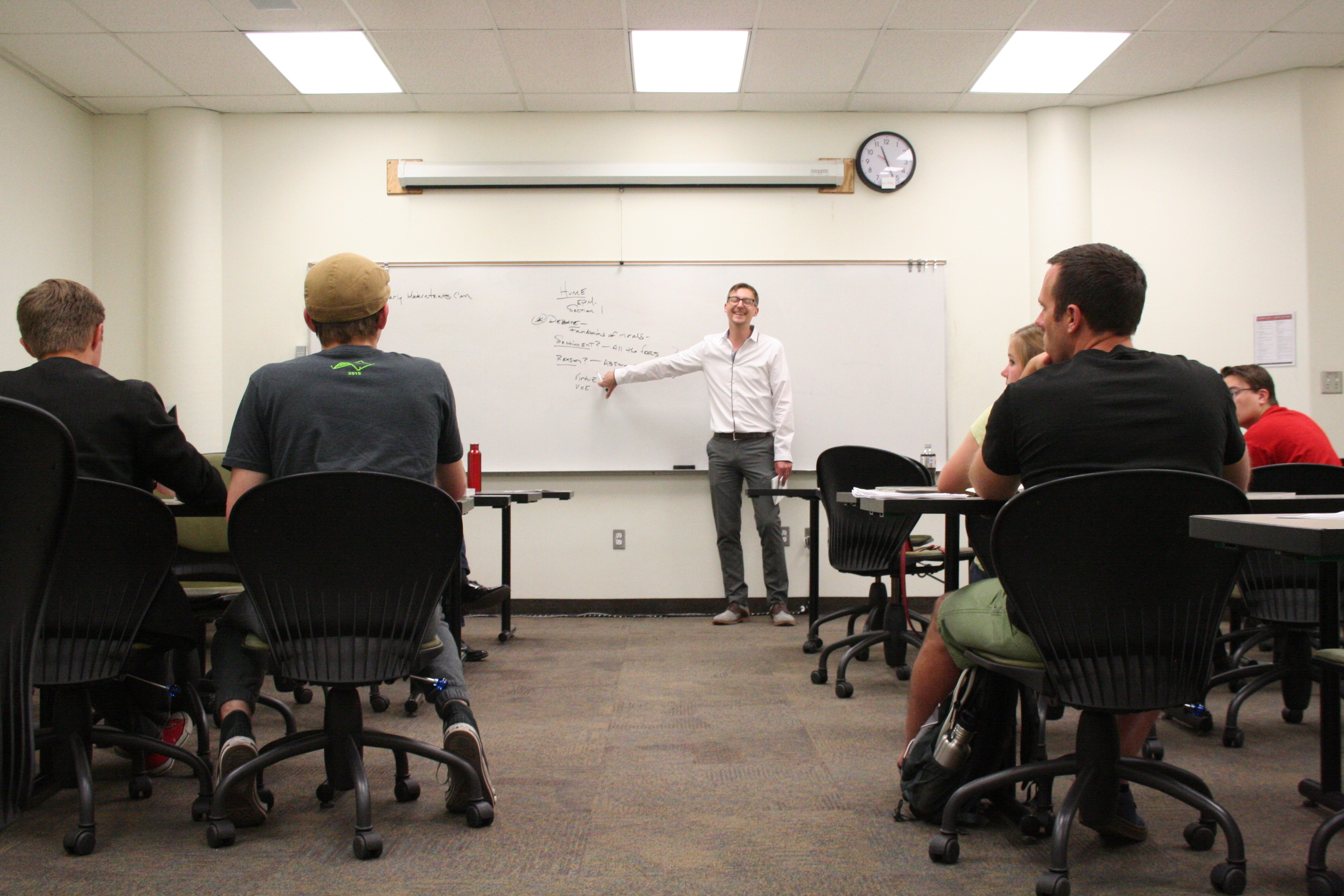 Dr. Kris Phillips engages students in a discussion about utility and benevolence, Cedar City, Utah, June 9, 2016 | Photo by Kaleigh Bronson, St. George News