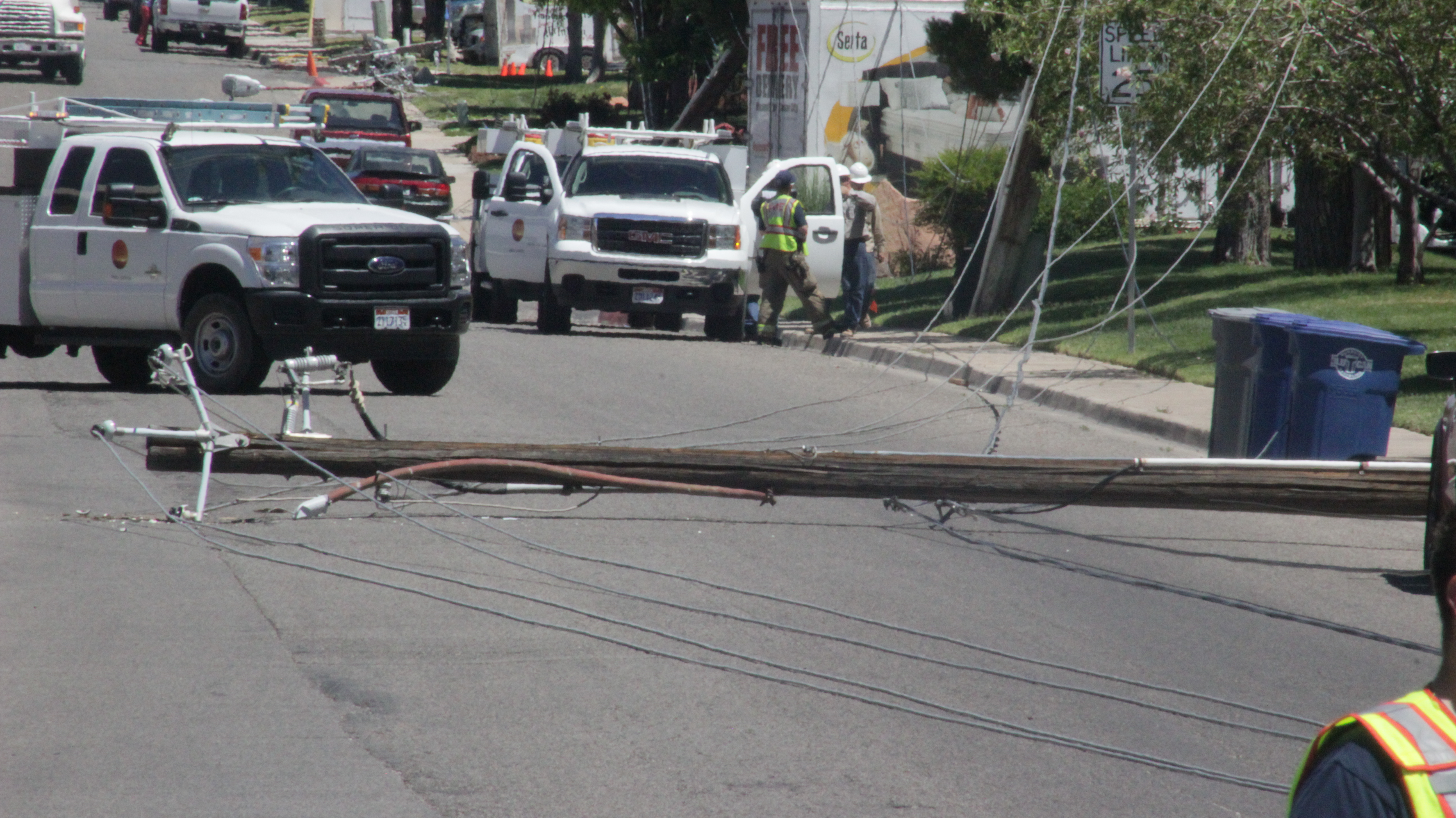 A furniture truck snagged a low-hanging cable line, pulling down five power poles, St. George, Utah, June 17, 2016 | Photo by Don Gilman, St. George News