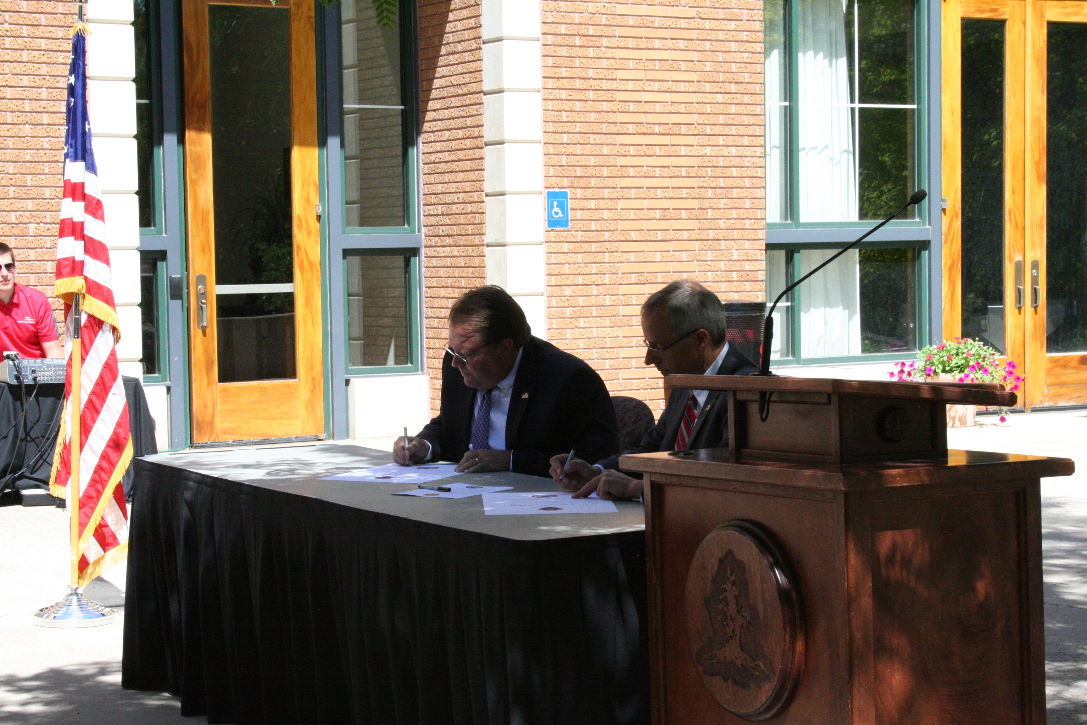 SUU President Scott Wyatt and Board of Trustees Chairman Eric Leavitt join to sign the official proclamation designating Southern Utah University a Purple Heart Campus, Cedar City, Utah, June 24, 2016 | Photo by Kaleigh Bronson, St. George News / Cedar City News